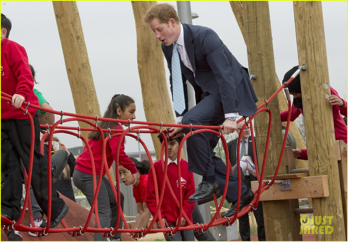 prince harry playing with kids at a playground 133084702