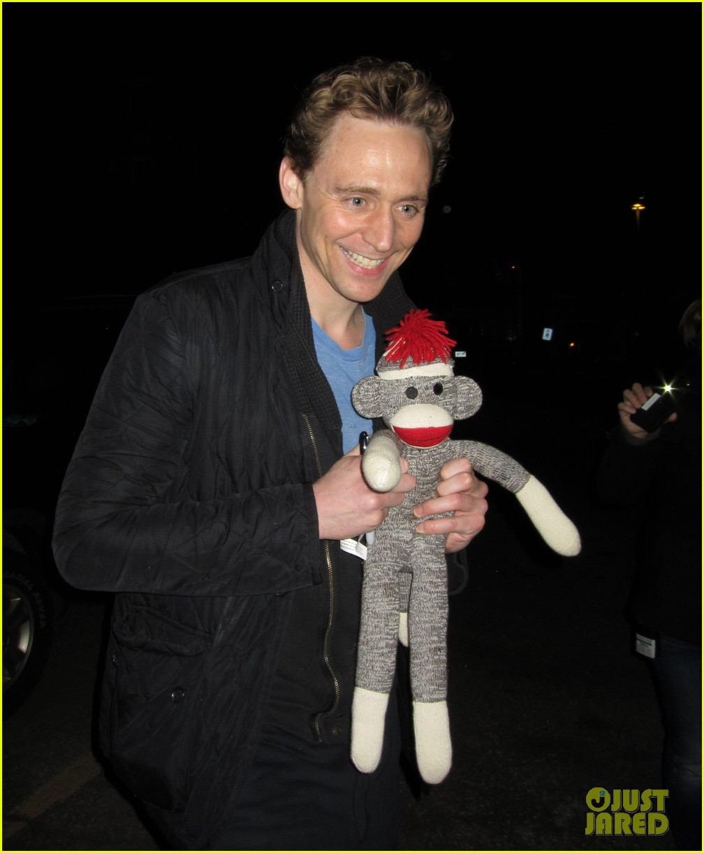 tom hiddleston happily accepts stuffed monkey gift 053099173
