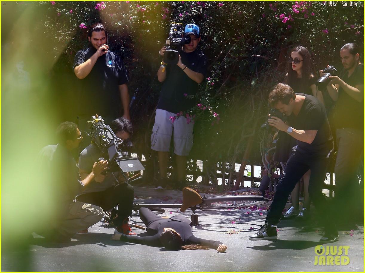 kim kardashian falls off bike in seemingly staged moment 01