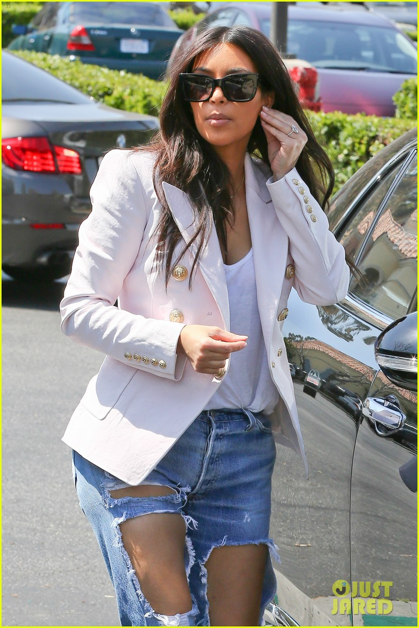 kim kardashian wears jeans with giant rips in them 02