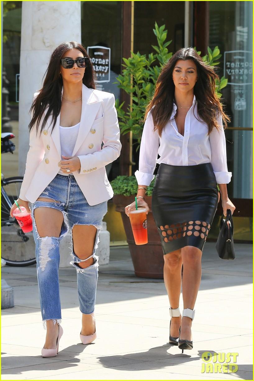 kim kardashian wears jeans with giant rips in them 123096304