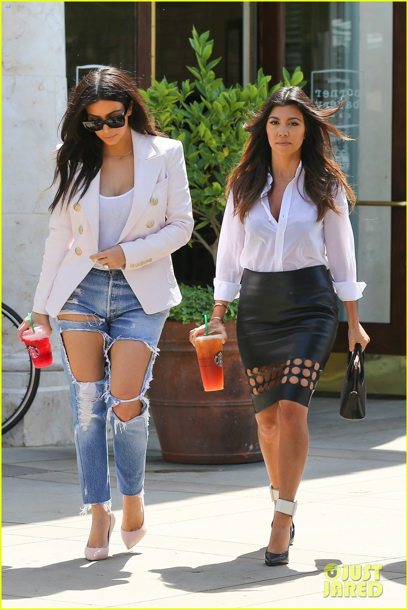 kim kardashian wears jeans with giant rips in them 193096311