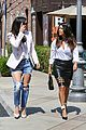 kim kardashian wears jeans with giant rips in them 14