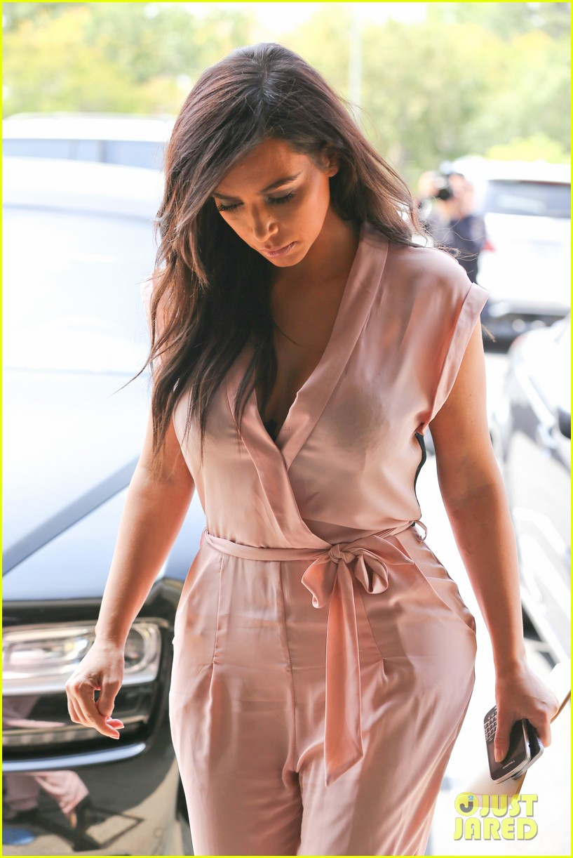 kim kardashian rocks pink jumpsuit with totally sheer back 253094696