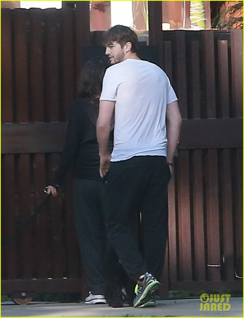 ashton kutcher shields mila kunis for easter sunday dog walk 03