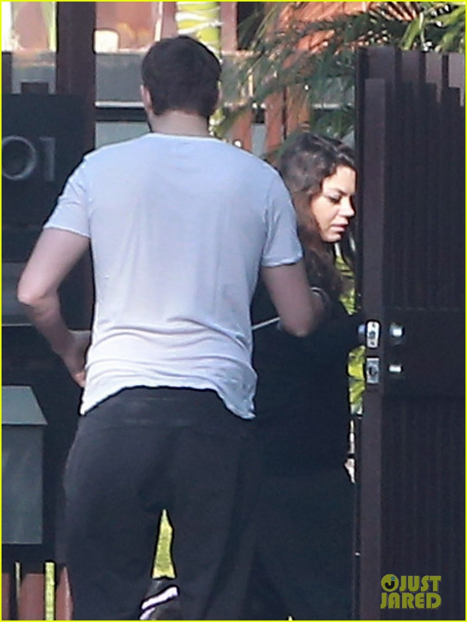ashton kutcher shields mila kunis for easter sunday dog walk 04