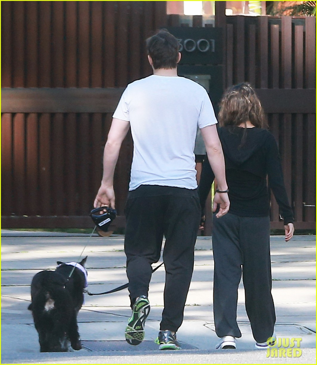 ashton kutcher shields mila kunis for easter sunday dog walk 09