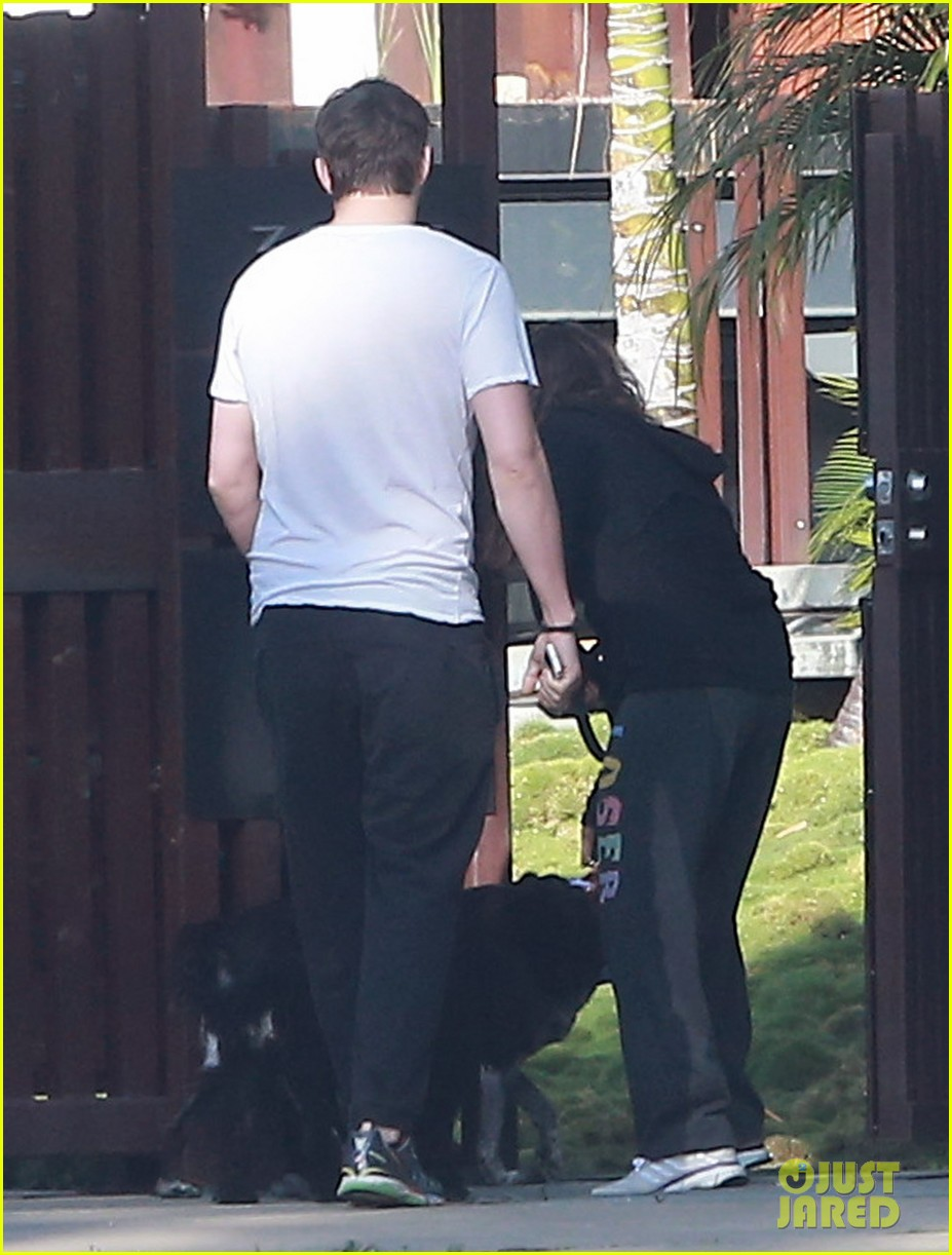 ashton kutcher shields mila kunis for easter sunday dog walk 103095808