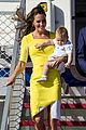 kate middleton changes into yellow dress to arrive in australia 23