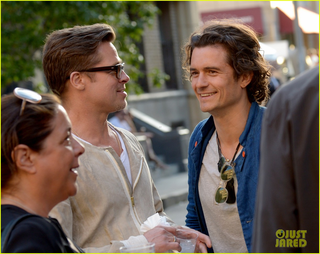 brad pitt orlando bloom reunite at paris photo l a private preview 023098979