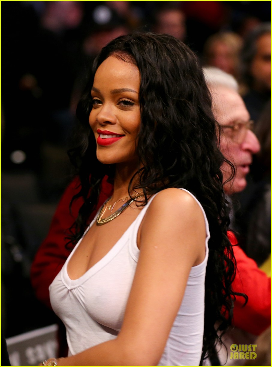 rihanna goes topless holds her boobs 02