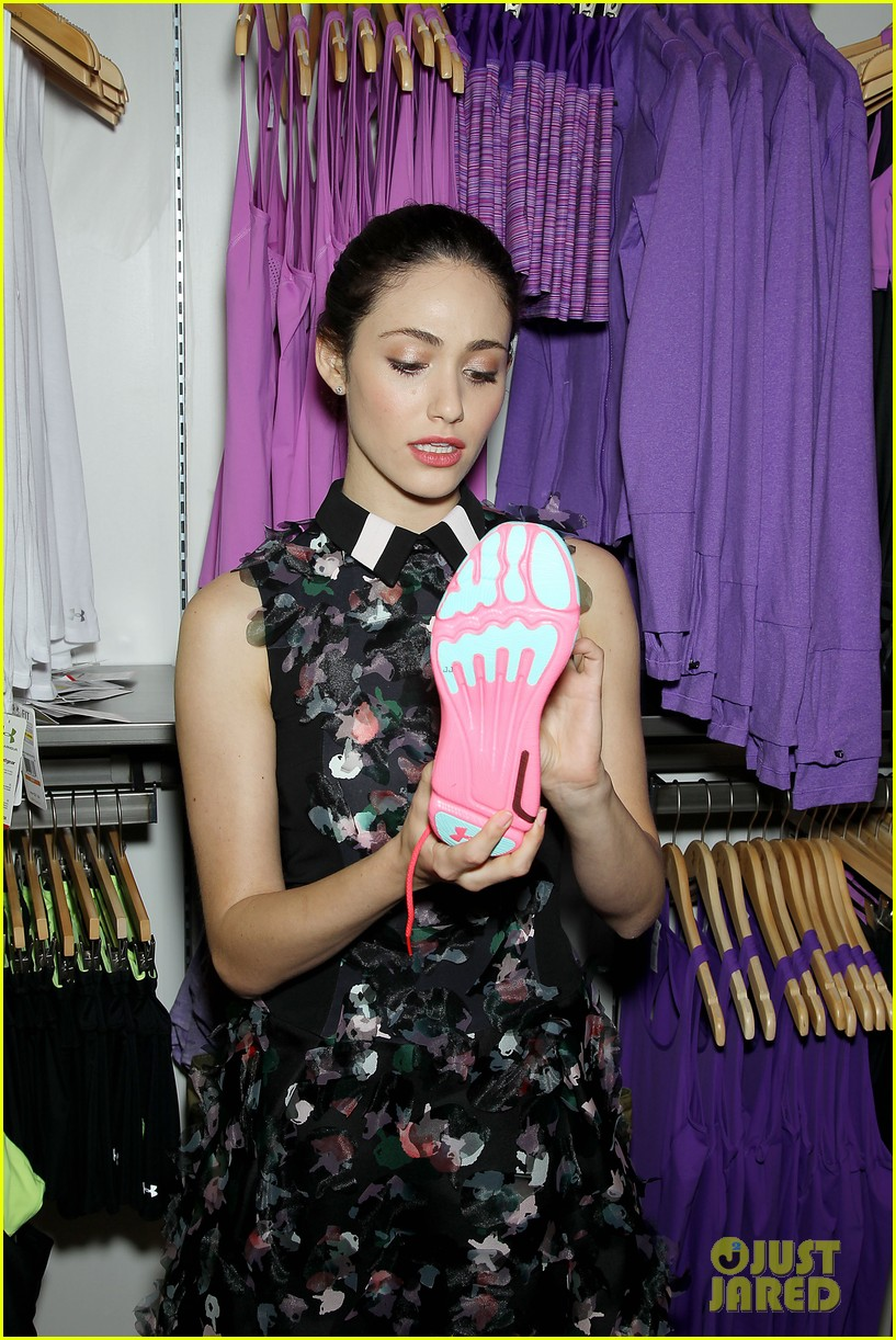 emmy rossum plays with shoes at under armour store launch 263102051