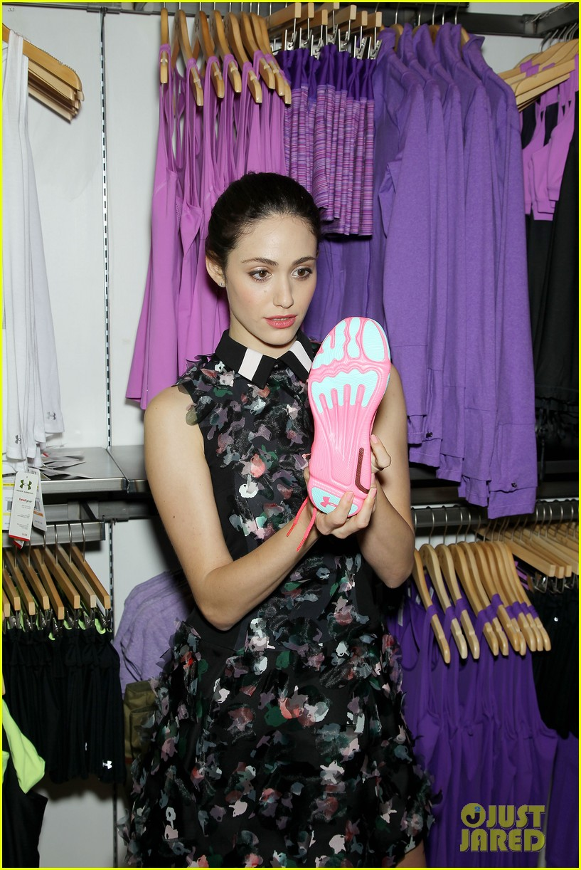 emmy rossum plays with shoes at under armour store launch 273102052