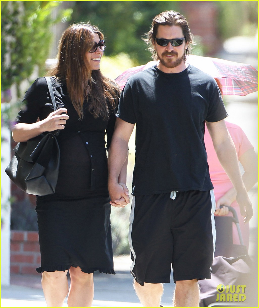 christian bale pregnant wife sibi hold hands 24