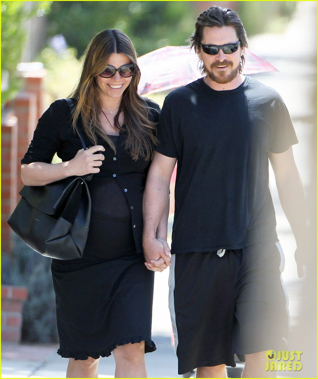 christian bale pregnant wife sibi hold hands 253119705