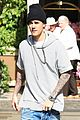 justin bieber holds onto van while riding skateboard 04