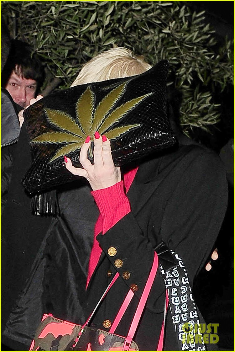 miley cyrus enters club fully clothed leaves in bra 07