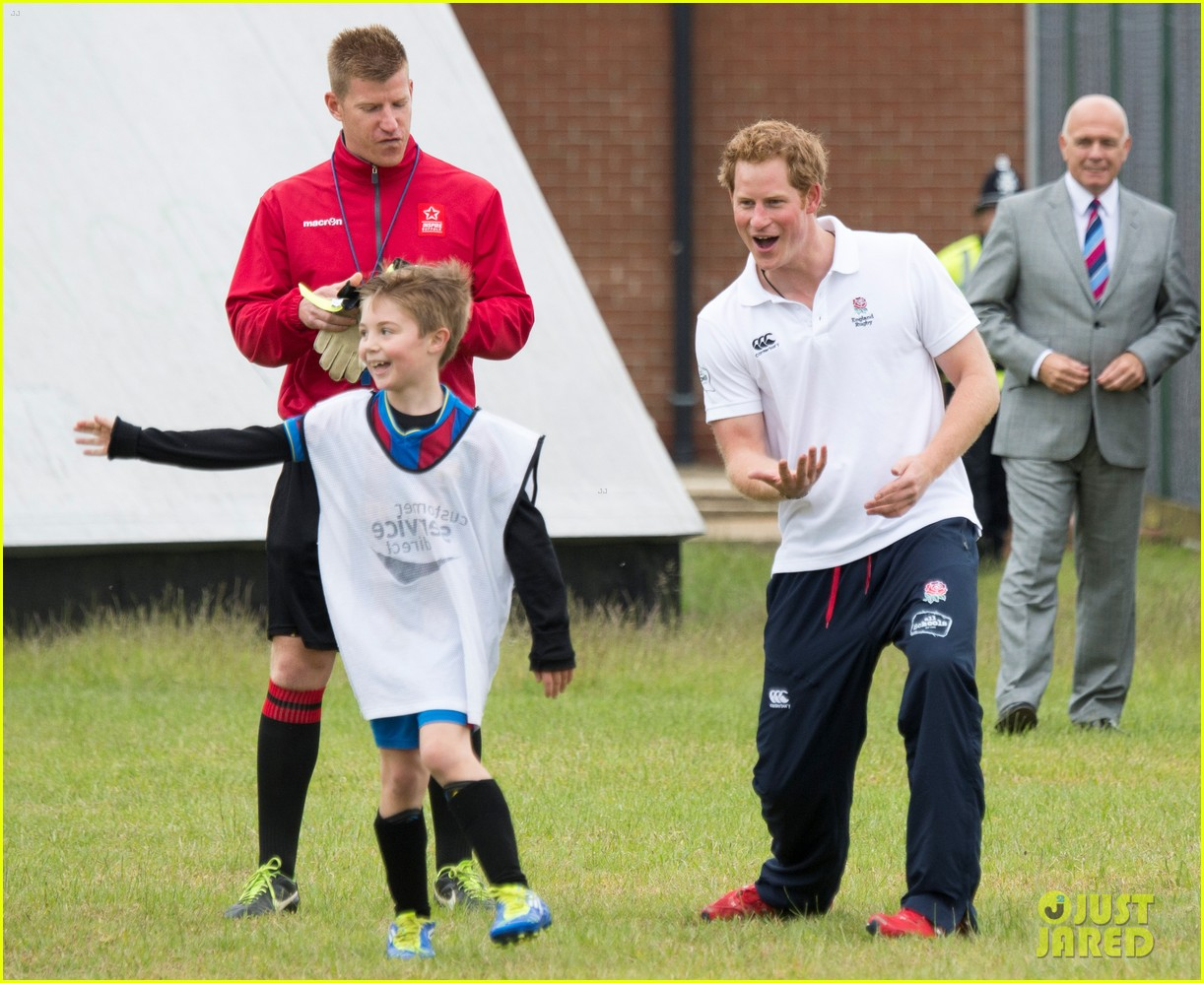 prince harry plays rugby schoolkids flashes his abs in the process 01