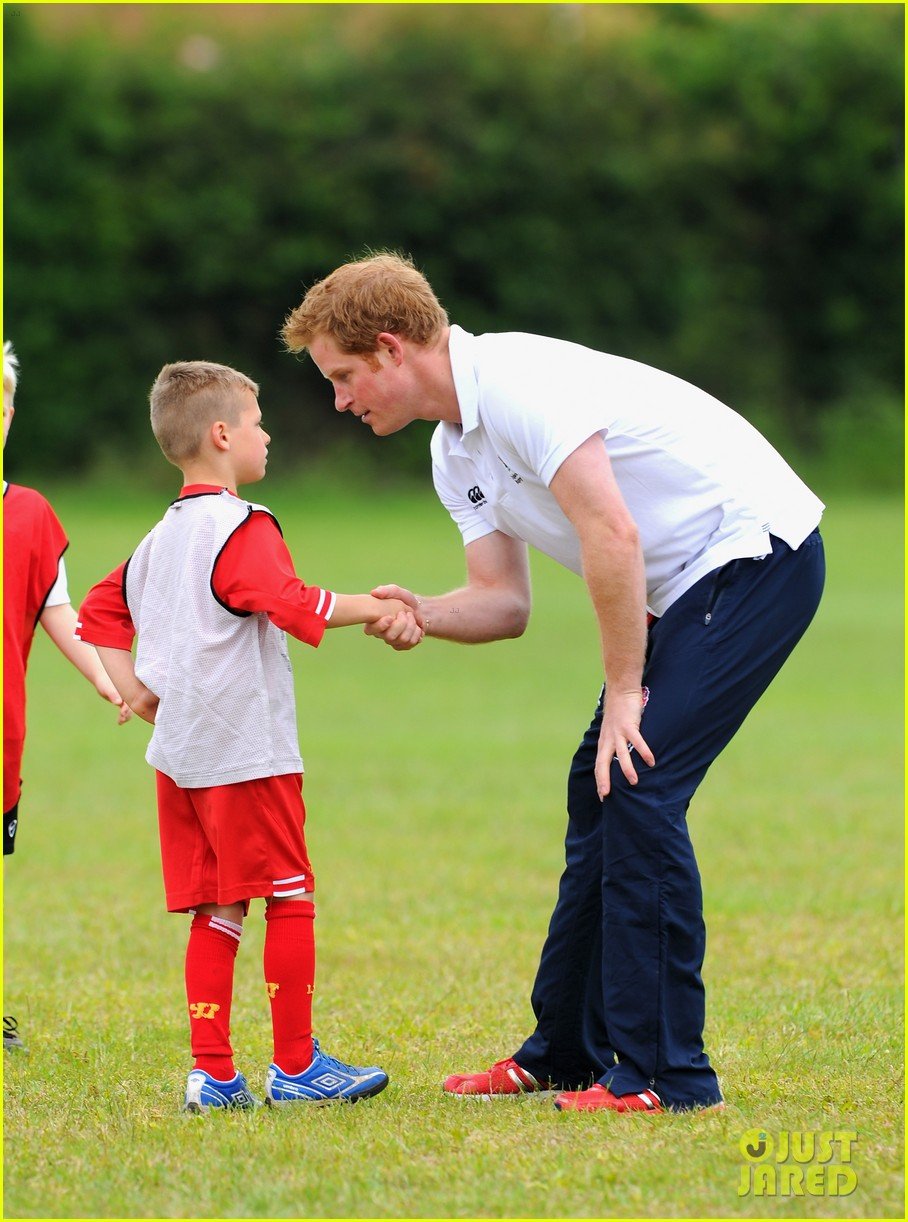 prince harry plays rugby schoolkids flashes his abs in the process 03