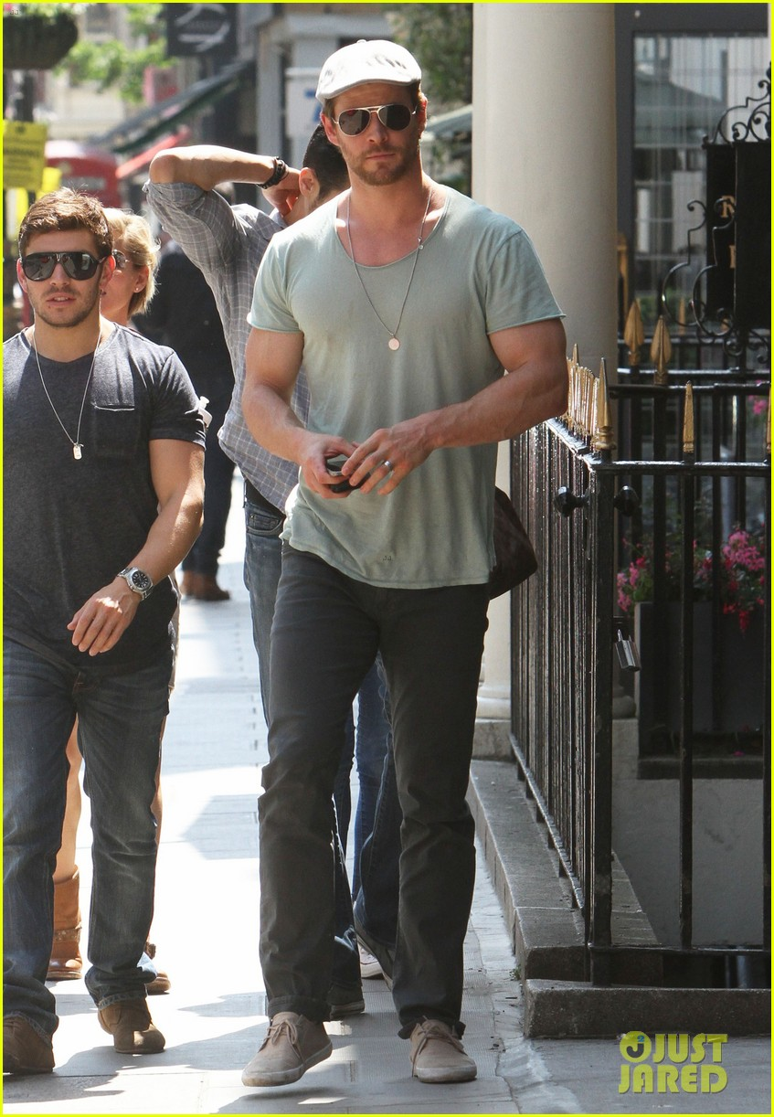 chris hemsworth pal is giving his muscles some competition 18