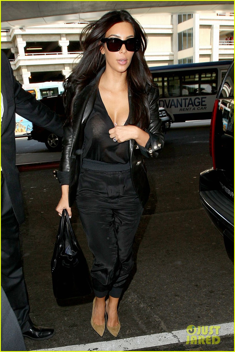 kim kardashian nipple peeks through sheer top at lax 033115882