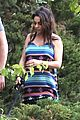 mila kunis hides her baby bump in loose fitting dress 16