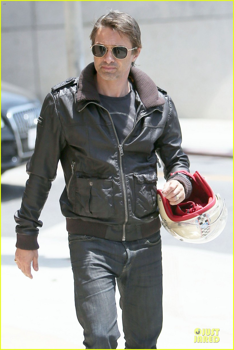 olivier martinez carrys motorcycle purse like a purse 123118672
