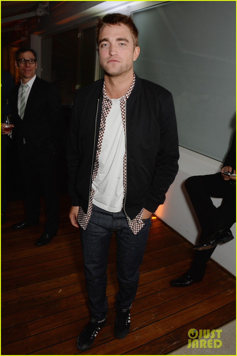 robert pattinson parties with hunger games stars in cannes 05