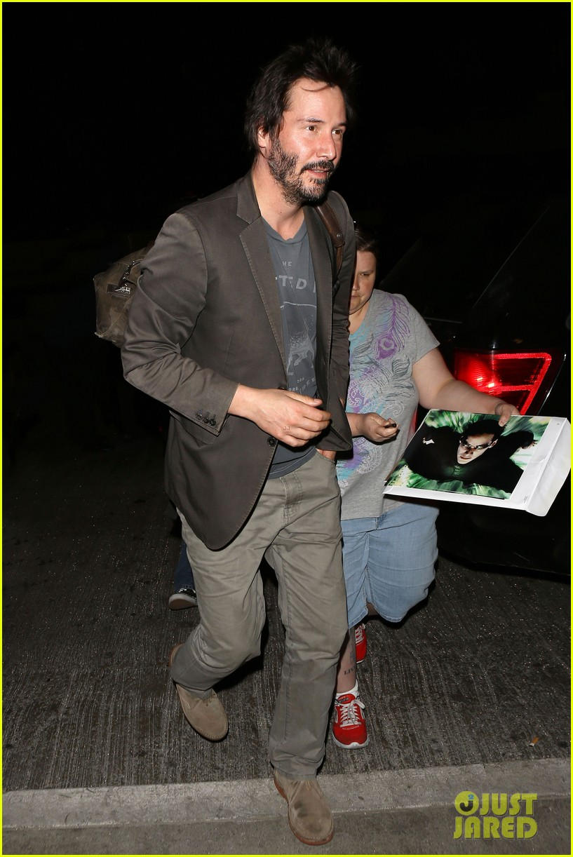 keanu reeves gets swarmed by fans at lax airport 01