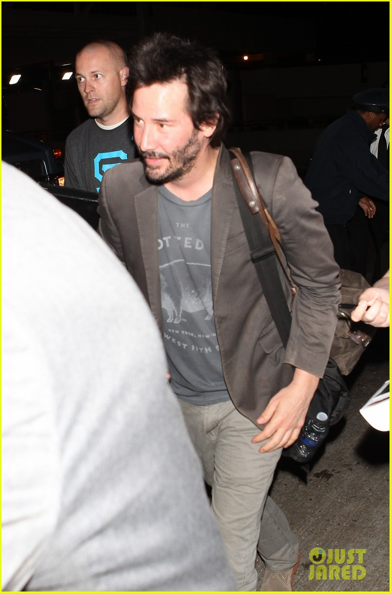keanu reeves gets swarmed by fans at lax airport 173125038