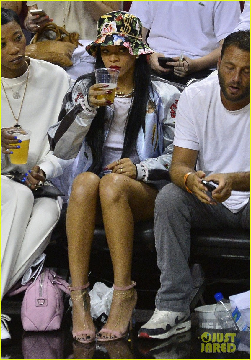 rihanna cheers on lebron james at nets heat game 12