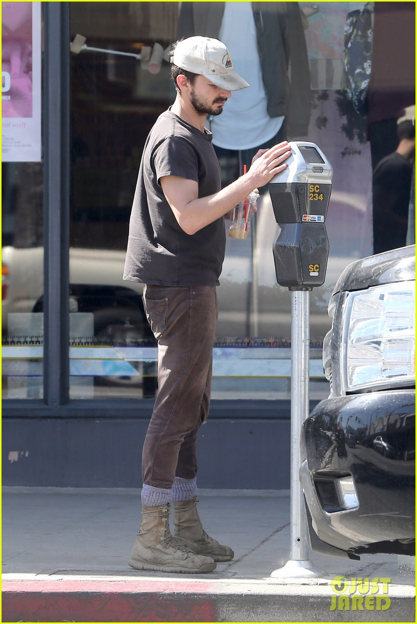 shia labeouf gives us a quick peek at his bare torso 24