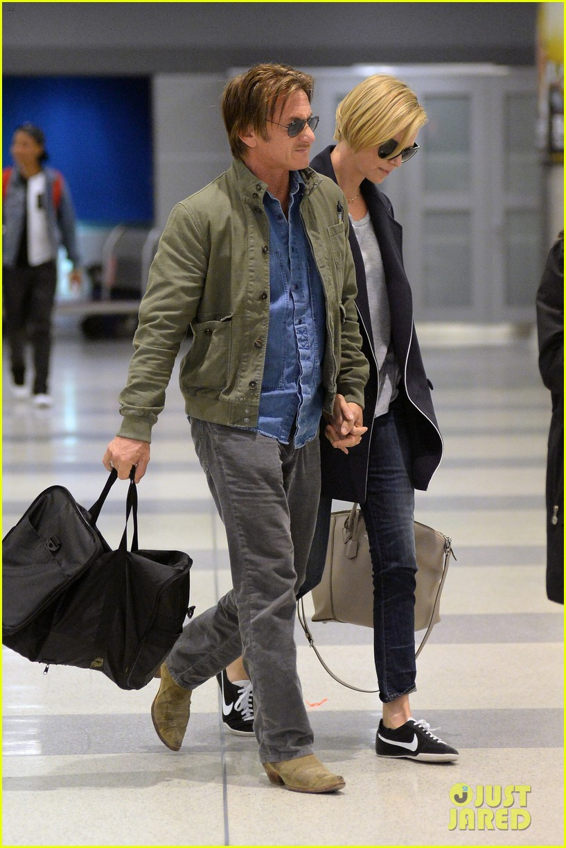charlize theron sean penn hold hands upon new york arrival 03