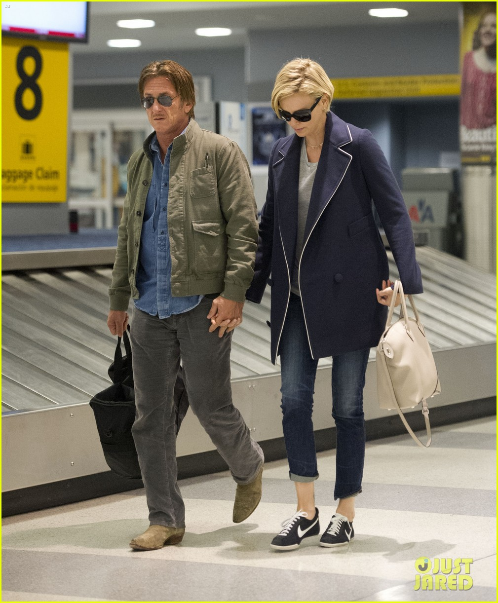 charlize theron sean penn hold hands upon new york arrival 283105582