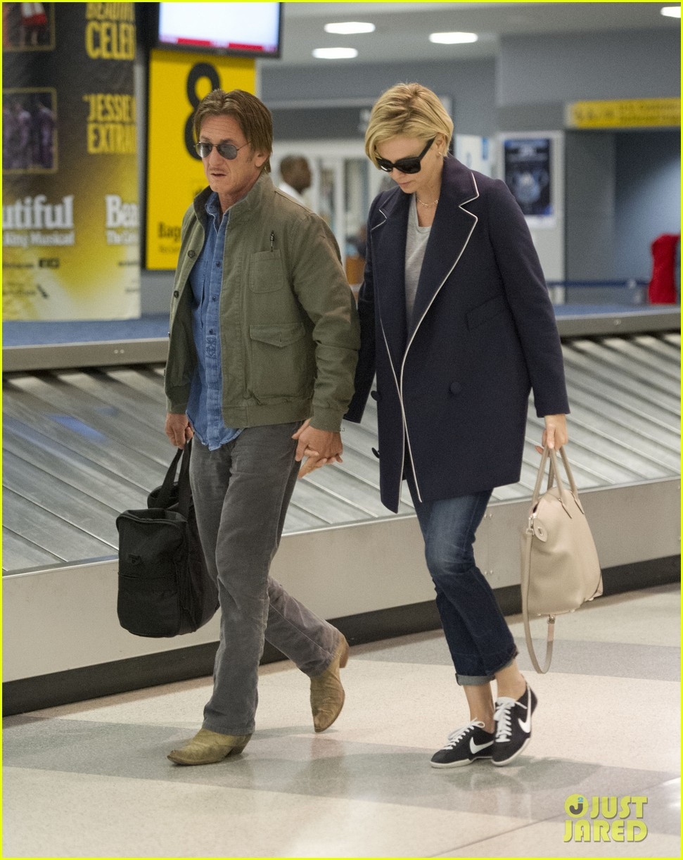 charlize theron sean penn hold hands upon new york arrival 33