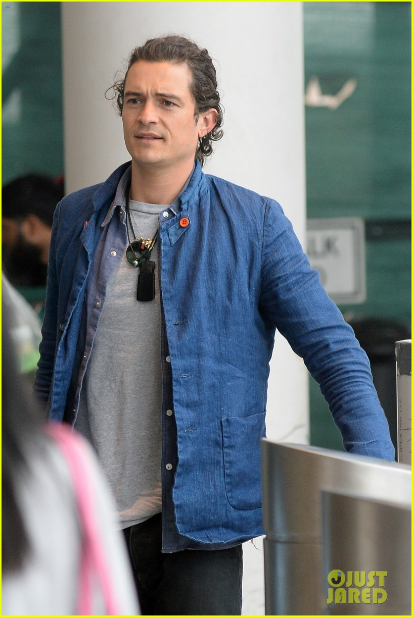 orlando bloom jets off after getting lap dance neil patrick harris 16