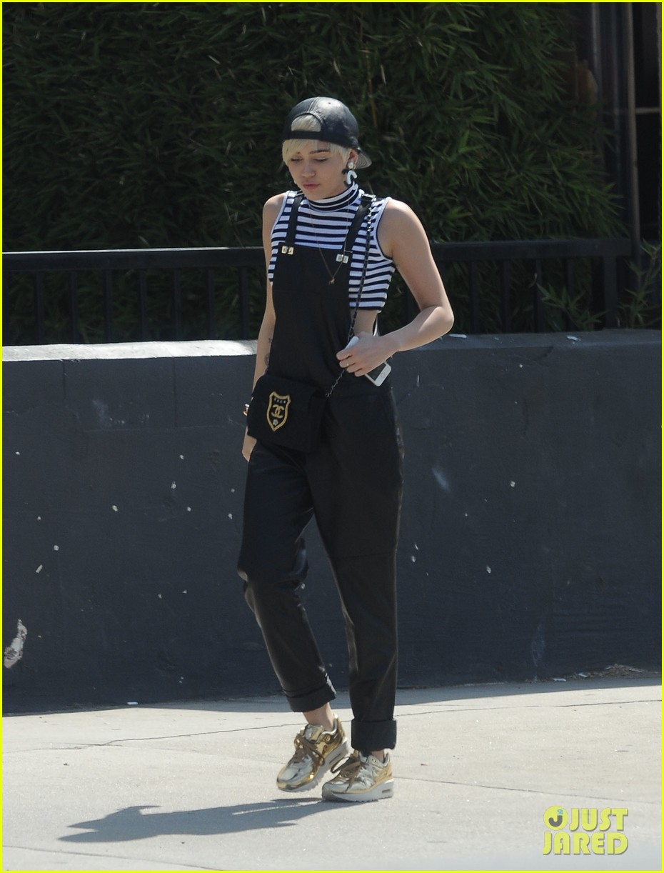 miley cyrus goes shopping after arriving home from europe 03