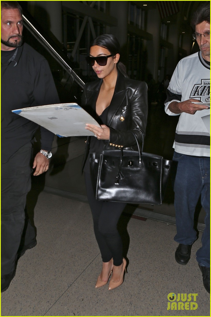 kim kardashian arrives at lax without new husband kanye west 073126207