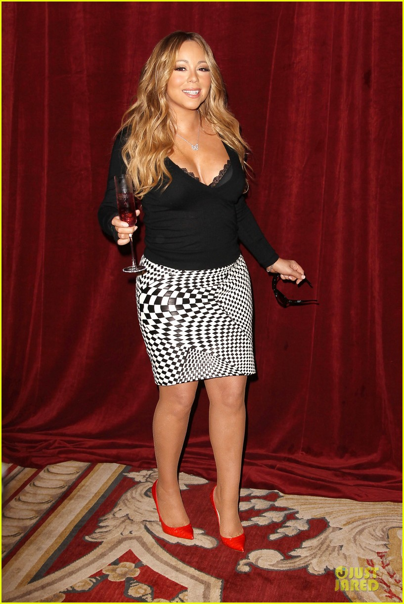 mariah carey bra gets exposure at butterfly launch 01