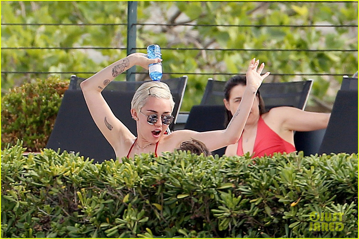 miley cyrus wears a bikini douses herself with water 11