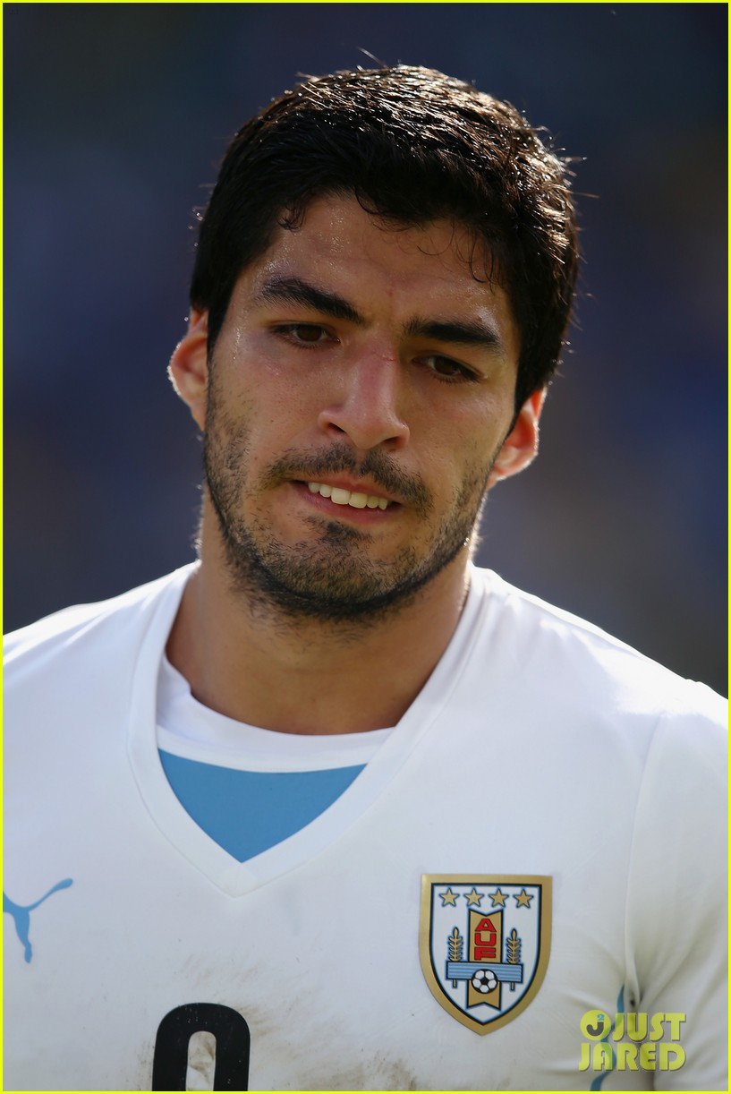luis suarez banned from world cup for biting opponent 043143919
