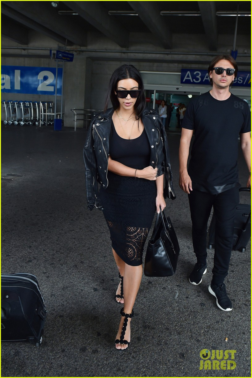 kim kardashian lands in nice while kanye west flies out 01