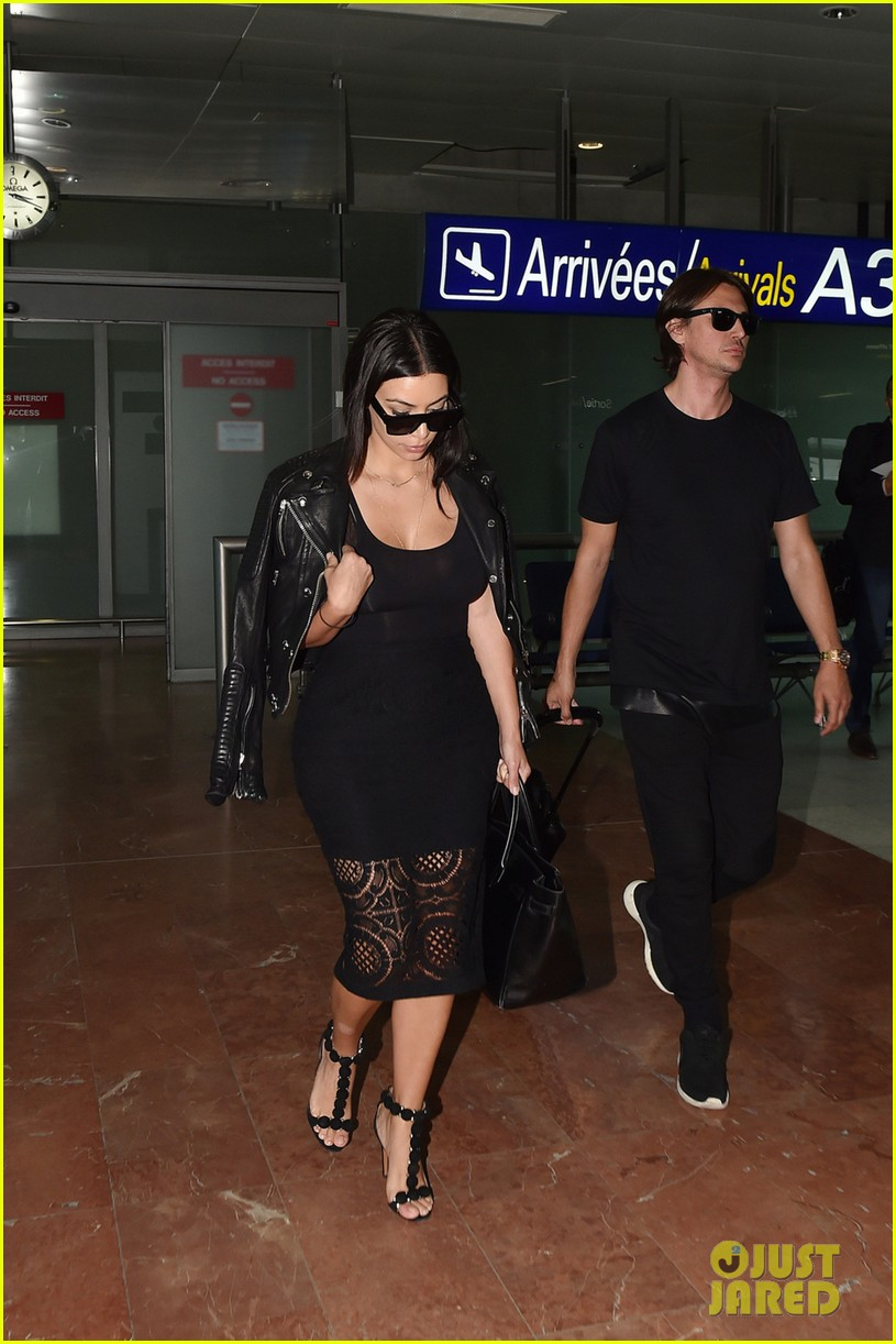 kim kardashian lands in nice while kanye west flies out 06