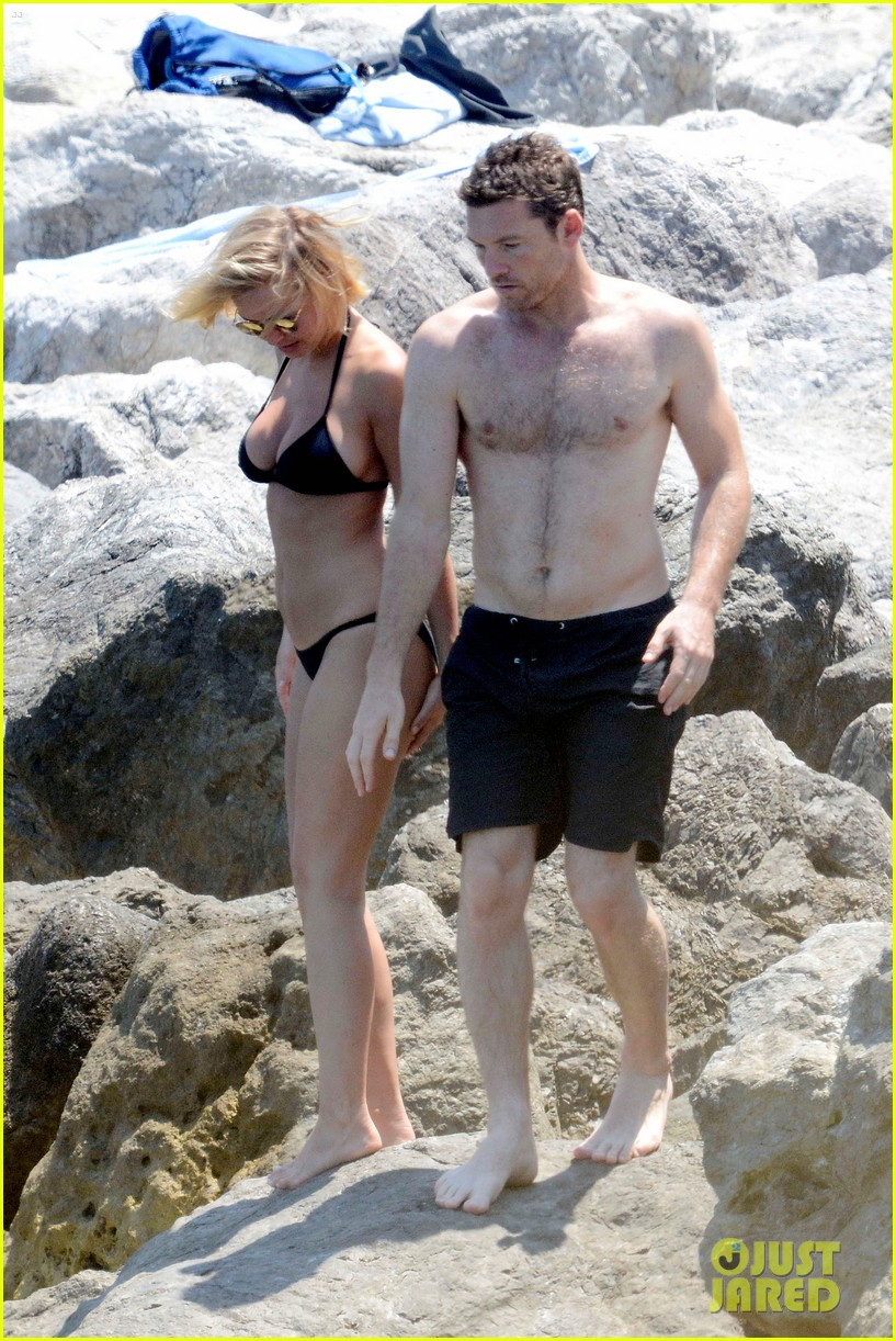 sam worthington lara bingle get handsy pack on the pda on beach 10
