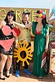 dita von teese flashes red bra in green dress 03