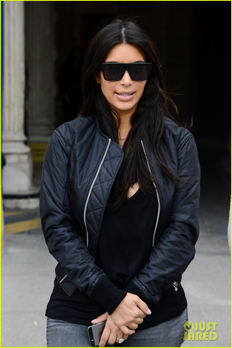 kim kardashian displays lots of cleavage for valentino fashion show 36