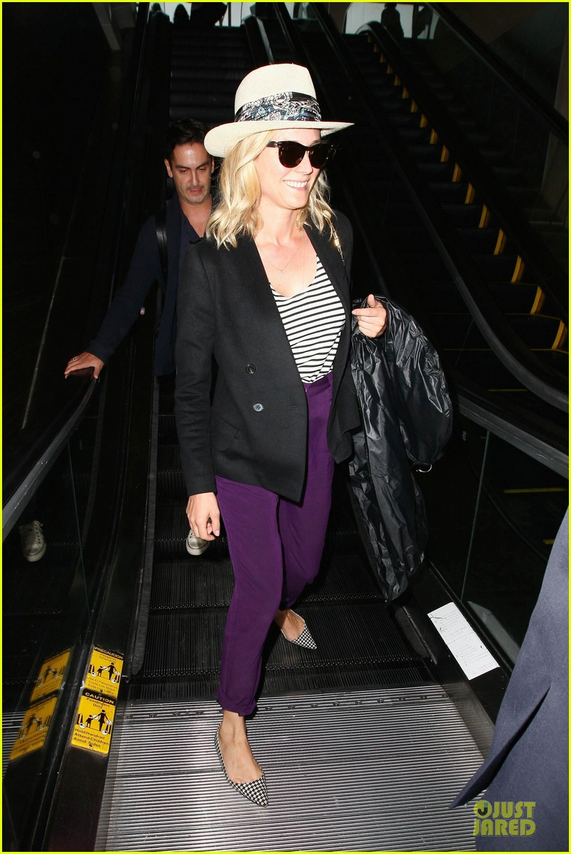 diane kruger wears purple pants at lax airport 05
