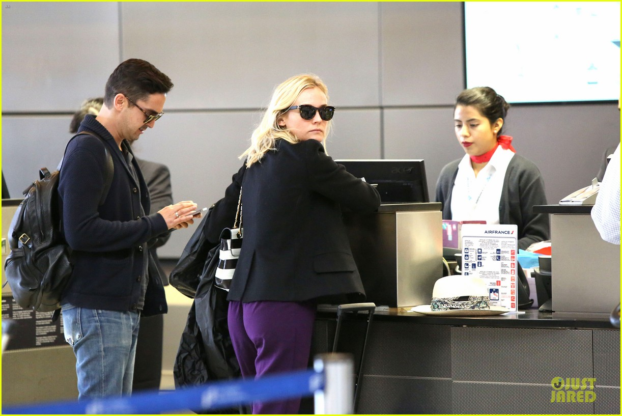 diane kruger wears purple pants at lax airport 09