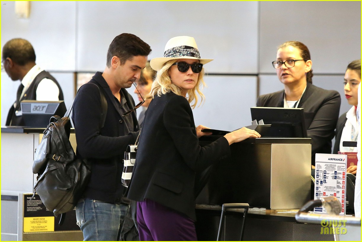 diane kruger wears purple pants at lax airport 10