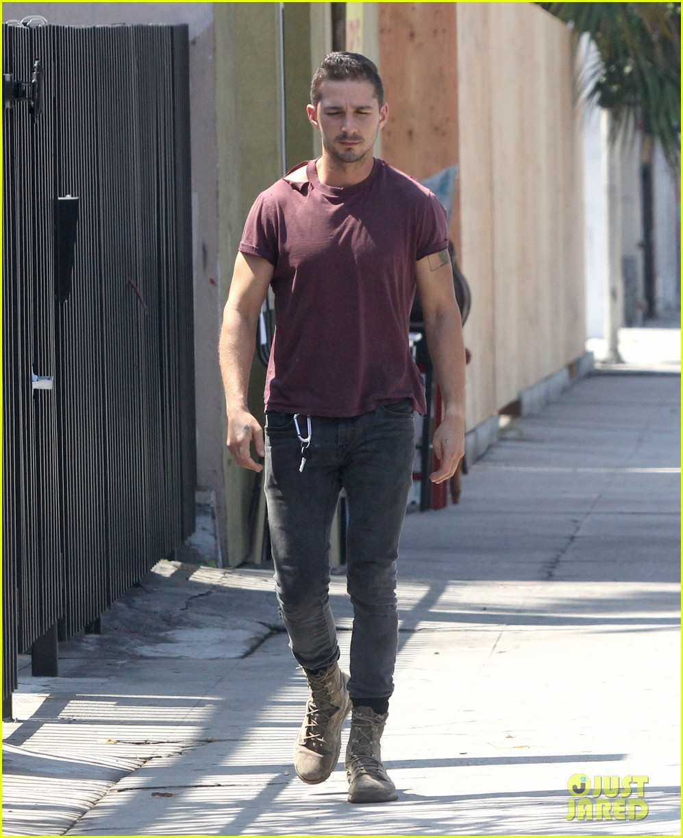 shia labeouf lifts his shirt bares torso 073153174